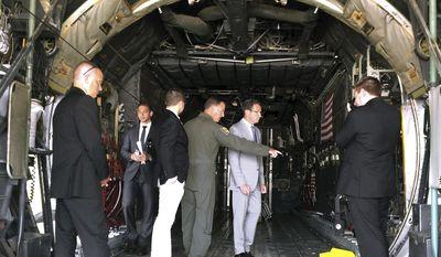 Col. Frank Detorie, left, commander of the 103rd Airlift Wing at the Bradley Air National Guard Base shows Connecticut Gov. Dannel P. Malloy the cargo area of a C-130 aircraft, Wednesday, July 26, 2017, in East Granby, Conn. Malloy was on hand to mark the opening of a new, $14.3 million, federally funded maintenance facility for the Connecticut Air National Guard's fleet of eight C-130s. (AP Photo/Susan Haigh)