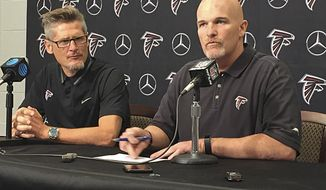 Atlanta Falcons general manager Thomas Dimitroff, left, and head coach Dan Quinn speak during a news conference at the start of NFL football training camp, Wednesday, July 26, 2017, in Flowery Branch, Ga. (AP Photo/Charles Odum)