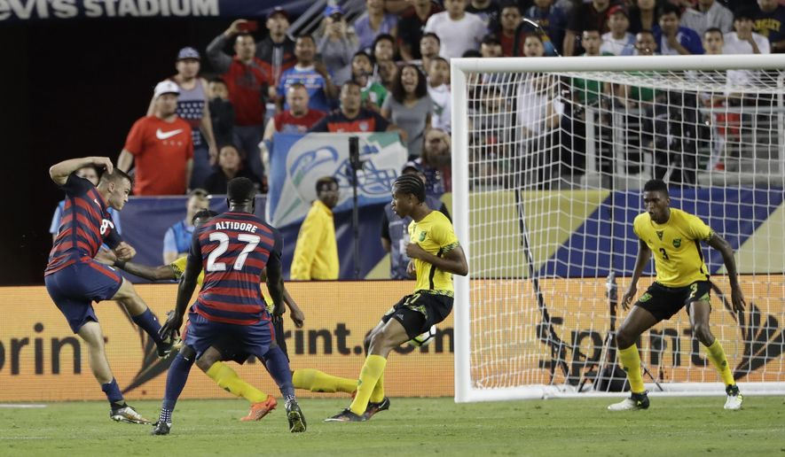 United States' Jordan Morris scores his team's second goal against Jamaica during the second half of the Gold Cup final soccer match in Santa Clara, Calif., Wednesday, July 26, 2017. (AP Photo/Marcio Jose Sanchez)