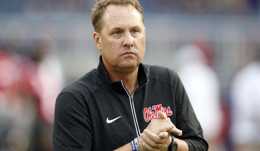 """FILE - In this Oct. 24, 2015, file photo, Mississippi football coach Hugh Freeze watches his team warmup before an NCAA college football game against Texas A&M in Oxford, Miss. USA Today reported July 25, 2017, that a charity foundation founded by Freeze is taking a break from fundraising and will reconsider its future days after the coach resigned amid what the school called a """"pattern of personal misconduct.""""  (AP Photo/Rogelio V. Solis, File)"""