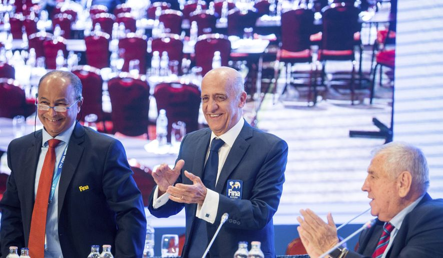 From left: International Swimming Federation, FINA Vice-President, Husain Al Musallam, President of FINA Julio Cesar Maglione and Executive Director of FINA, Cornel Marculescu are seen during the press conference after the FINA's congress at Hotel InterContinental in Budapest, Hungary, Saturday, July 22, 2017. (Zoltan Balogh/MTI via AP)