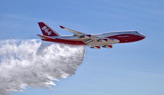 FILE - This May 5, 2016, file photo provided by Global Supertanker Services shows a Boeing 747 making a demonstration water drop at Colorado Springs Airport in Colorado Springs, Colo. Federal officials have given a giant airtanker capable of carrying 19,200 gallons (72,700 liters) approval to fight wildfires in the U.S., but a lack of contracts currently limits the aircraft to California and one county in Colorado. The U.S. Department of Agriculture's Interagency Airtanker Board issued the approval on Tuesday, July 25, 2017. (Hiroshi Ando/Global Supertanker Services via AP, File)
