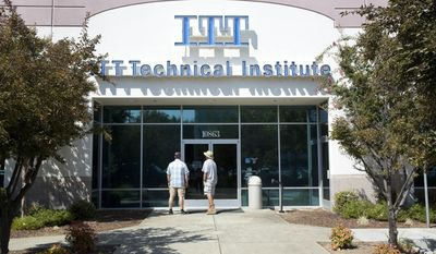 FILE - In this Sept. 6, 2016, file photo, Harold Poling, left, and Ted Weisenberger check the doors to the ITT Technical Institute after ITT Educational Services announced that the school had ceased operating in Rancho Cordova, Calif. The U.S. Education Department has not approved any applications for student-loan forgiveness in cases of possible fraud since President Donald Trump took office, according to records sent to an Illinois senator. The records also revealed that the department has continued to receive new applications from borrowers who say they were victims of fraud, mostly from Corinthian borrowers and from former students of ITT Technical Institute. (AP Photo/Rich Pedroncelli, File)