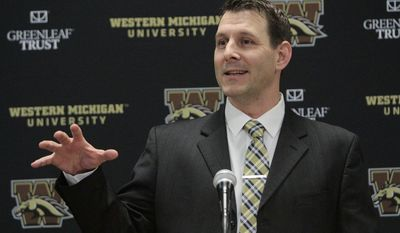 In this Jan. 14, 2017, photo, Tim Lester speaks as he made his first public appearance as the new NCAA college football head coach at Western Michigan University, in Kalamazoo, Mich. The planets aligned for long-suffering Western Michigan last season, earning the Broncos their first Mid-American Conference Championship since 1988 and a major bowl bid. (Jake Green/Kalamazoo Gazette-MLive Media Group via AP)