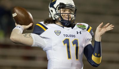 FILE - In this Jan. 4, 2015, file photo, Toledo quarterback Logan Woodside (11) passes the ball during the first half of the GoDaddy Bowl NCAA college football game, in Mobile, Ala. Toledo is loaded and will give Western Michigan a run, while Ohio and Miami are again expected to top the MAC East again.  (AP Photo/Brynn Anderson, File)