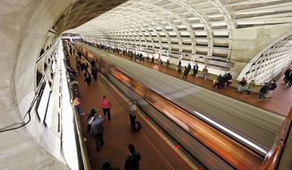 A Metro train departs the Gallery Place-Chinatown Metro station in Washington on March 15, 2016. (Associated Press) **FILE**