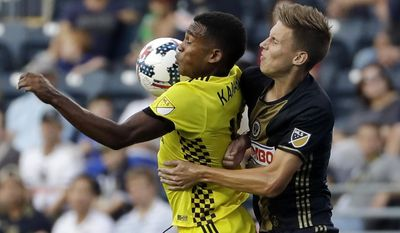 Columbus Crew's Ola Kamara, left, and Philadelphia Union's Jack Elliott leap for the ball during the first half of an MLS soccer match, Wednesday, July 26, 2017, in Chester, Pa. (AP Photo/Matt Slocum)
