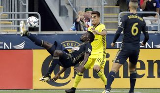 Philadelphia Union's C.J. Sapong, left, kicks the ball as Columbus Crew's Hector Jimenez, center, and Union's Haris Medunjanin look on during the first half of an MLS soccer match, Wednesday, July 26, 2017, in Chester, Pa. (AP Photo/Matt Slocum)