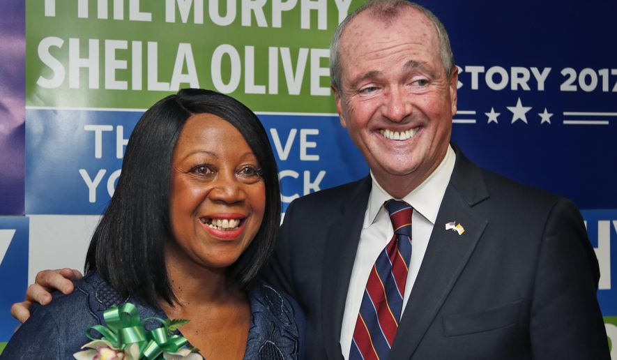 Democratic candidate for New Jersey governor Phil Murphy poses for pictures with the candidate for lieutenant governor, Sheila Oliver, during a news conference in Newark, N.J., Wednesday, July 26, 2017. Murphy announced that Assemblywoman Oliver is joining his ticket as the candidate for lieutenant governor. (AP Photo/Seth Wenig)