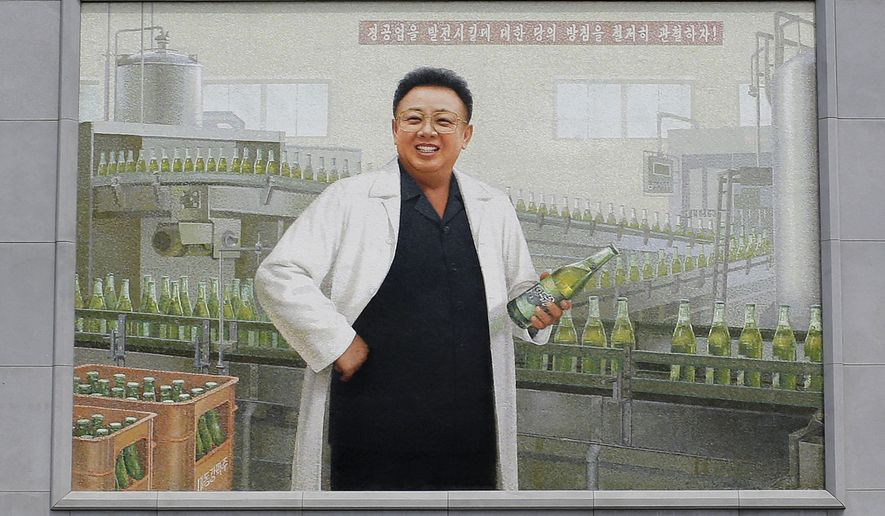 In this Wednesday, July 26, 2017, photo, a mural of the late North Korean leader Kim Jong Il in a white lab coat holding up a bottle of beer is seen at the entrance of the Taedonggang Brewery in Pyongyang, North Korea. Taedonggang beers are generally reputed to be world-class, which is a matter of national pride among many North Koreans. (AP Photo/Wong Maye-E)