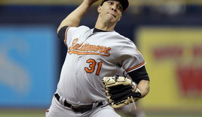 Baltimore Orioles starting pitcher Ubaldo Jimenez delivers to the Tampa Bay Rays during the first inning of a baseball game Wednesday, July 26, 2017, in St. Petersburg, Fla. (AP Photo/Chris O'Meara)