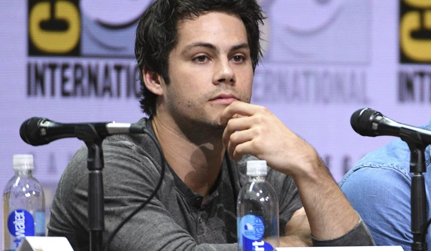 """FILE - In this July 20, 2017 file photo, Dylan O'Brien appears at the """"Teen Wolf"""" panel on during Comic-Con International in San Diego. O'Brien said Monday that filming his starring role in """"American Assassin"""" helped him recover from serious injuries he sustained on the the set of """"The Maze Runner: The Death Cure"""" in March 2016. (Photo by Al Powers/Invision/AP, File)"""