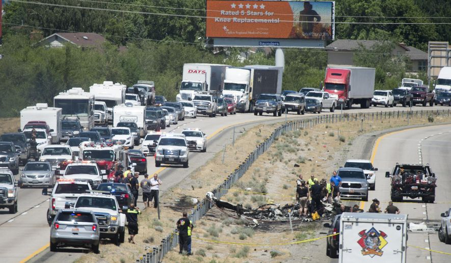 Four people died when their small plane crashed in the middle of I-15 near Riverdale, Utah, Wednesday, July 26, 2017. The crash closed the freeway to northbound traffic. (Rick Egan/The Salt Lake Tribune via AP)