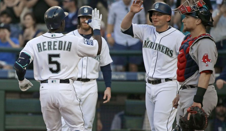 Seattle Mariners' Guillermo Heredia (5) is greeted at the plate as Boston Red Sox catcher Christian Vazquez watches after Heredia hit a three-run home run during the second inning of a baseball game Tuesday, July 25, 2017, in Seattle. (AP Photo/Ted S. Warren)