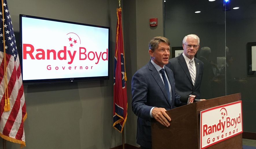 Tennessee gubernatorial candidate Randy Boyd, at podium, speaks to reporters as Shelby County Mayor Mark Luttrell, right, listens Wednesday, July 26, 2017, in Memphis, Tenn. Luttrell endorsed Boyd, a fellow Republican, in the 2018 Tennessee governor's race. (AP Photo/Adrian Sainz)