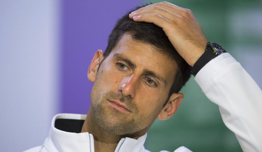 FILE - This is a Wednesday, July 12, 2017 file photo of  Serbia's Novak Djokovic as he gestures during a press conference after losing his Men's Singles Quarterfinal Match against Czech Republic's Tomas Berdych on day nine at the Wimbledon Tennis Championships in London. Novak Djokovic will miss the rest of this season because of an injured right elbow. The 12-time major champion will skip the U.S. Open. That ends his streak of playing in 51 consecutive Grand Slam tournaments. (AELTC, Joe Toth/File via AP)