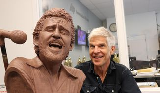 Sculptor Kevin Kresse appears with a bust he created of the late musician Levon Helm, Wednesday, July 26, 2017, in Little Rock, Ark. The bust, once bronzed, will be part of a memorial to the performer, who grew up near Turkey Scratch in eastern Arkansas. (AP Photo/Kelly P. Kissel)