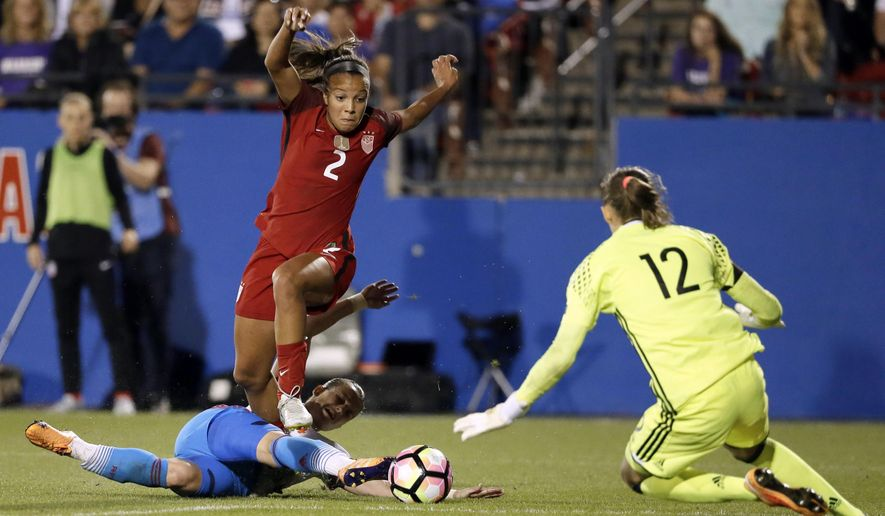 FILE -  In this April 6, 2017, file photo, United Sates midfielder Mallory Pugh (2) is tripped by Russia defender Tatiana Sheikina, bottom, at the net as Russia goalie Alena Belyaeva (12) defends against the attack in the the second half of an international friendly soccer match in Frisco, Texas. Pugh is on the U.S. roster for the upcoming Tournament of Nations, starting Thursday, July 27, 2017,  in Seattle. The 19-year-old grabbed headlines earlier this year when she decided to eschew a college career at UCLA to go pro.  (AP Photo/Tony Gutierrez, File)