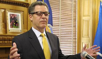 FILE - In this June 7, 2017 file photo, Kansas Gov. Sam Brownback speaks during a news conference at the Statehouse in Topeka, Kan. President Donald Trump will Brownback as ambassador at large for international religious freedom. (AP Photo/John Hanna, File)