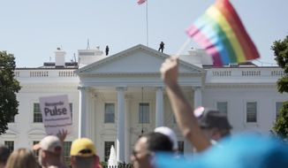 FILE - In this Sunday, June 11, 2017 file photo, Equality March for Unity and Pride participants march past the White House in Washington. Most LGBT-rights activists never believed Donald Trump's campaign promises to be their friend. With his move to ban transgender people from military service on Wednesday, July 26, 2017, on top of other actions and appointments, they now see him as openly hostile. (AP Photo/Carolyn Kaster)