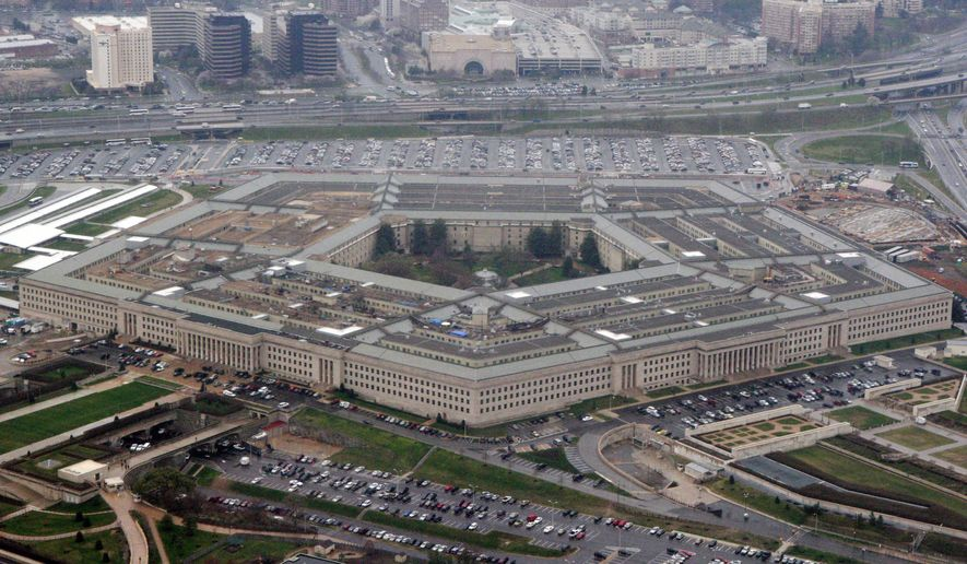 In this March 27, 2008, file photo, the Pentagon is seen in this aerial view in Washington. (AP Photo/Charles Dharapak, File)