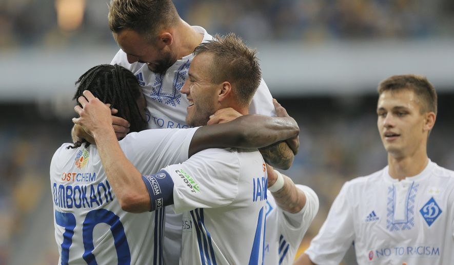 Dynamo Kiev's Dieumerci Mbokani, left, celebrates with his teammates scoring his side's second goal during the Champions League third qualifying round, 1st leg soccer match between Dynamo Kiev and Young Boys at the Olympiyskiy Stadium in Kiev, Ukraine, Wednesday, July 26, 2017. (AP Photo/Efrem Lukatsky)