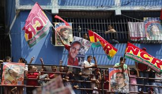 People participate in a pro-government candidates' rally in Caracas, Venezuela, Tuesday, July 25, 2017. Across Venezuela, pro-government candidates to the Constitutional Assembly held their last campaign rallies ahead of Sunday's historical vote. (AP Photo/Ariana Cubillos)