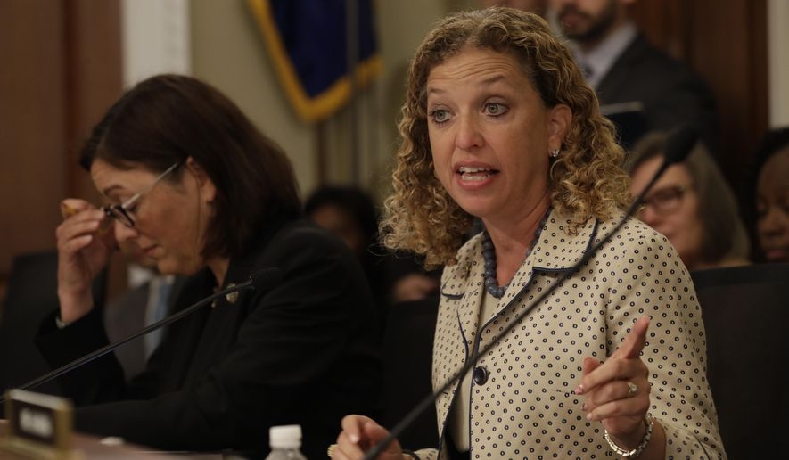 In this May 24, 2017, file photo, House Budget Committee member Rep. Debbie Wasserman Schultz, D-Fla., questions Budget Director Mick Mulvaney on Capitol Hill in Washington during the committee's hearing on President Donald Trump's fiscal 2018 federal budget. Fellow committee member Rep. Susan DelBene, D-Wash. is at left. Wasserman Schultz fired IT staffer Irman Awan on July 25, 2017, following his arrest on a federal bank fraud charge. (AP Photo/Jacquelyn Martin, File)