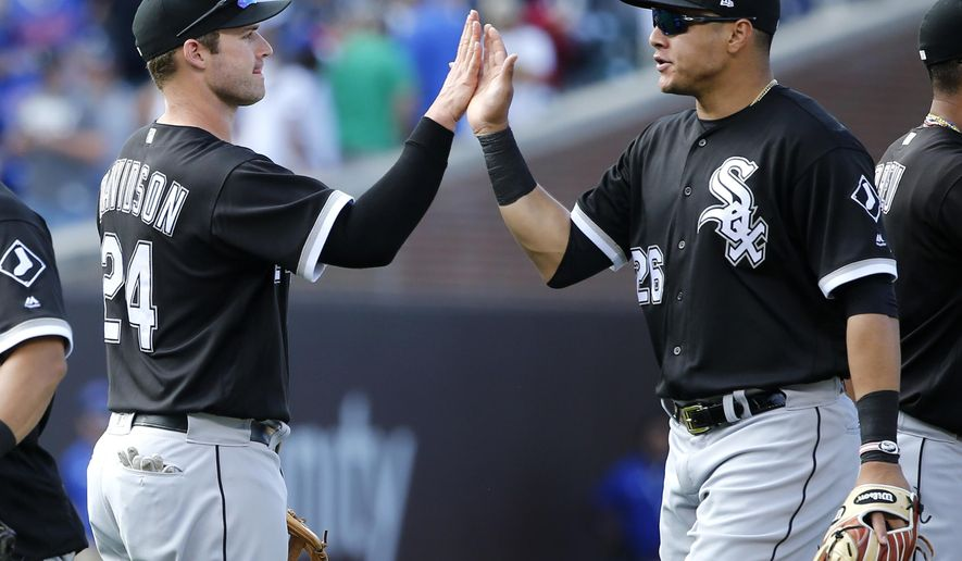 Chicago White Sox's Matt Davidson (24) and Avisail Garcia celebrate their win over the Chicago Cubs after a baseball game Monday, July 24, 2017, in Chicago. (AP Photo/Charles Rex Arbogast)