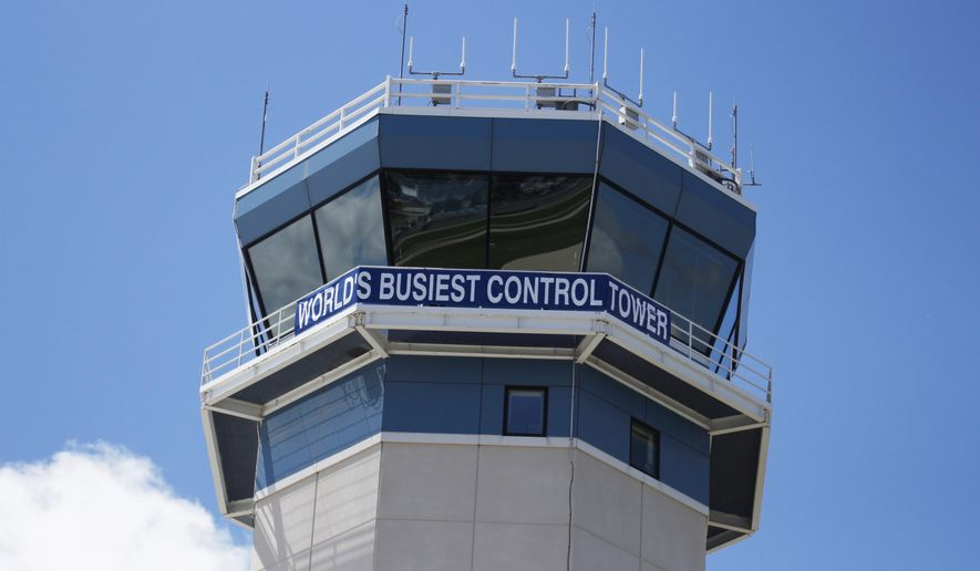This photo taken Monday, July 24, 2017 shows the tower at Wittman Regional Airport in Oshkosh, Wis. It is the host airport to the Experimental Aircraft Association's annual gathering, AirVenture. The airport becomes the busiest in the world during the week-long event with 10,000 planes expected at the event, according to the Federal Aviation Administration. (AP Photo/Carrie Antlfinger)