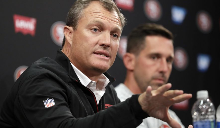 San Francisco 49ers general manager John Lynch, left, and head coach Kyle Shanahan field questions during the NFL team's football training camp Thursday, July 27, 2017, in Santa Clara, Calif. (AP Photo/Marcio Jose Sanchez)