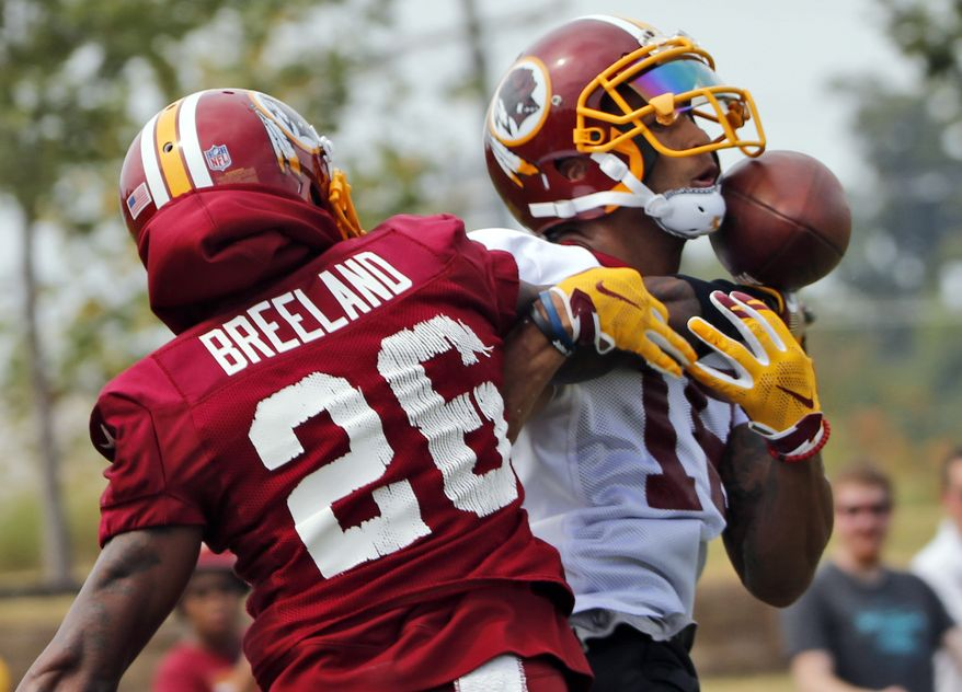Washington Redskins cornerback Bashaud Breeland (26) breaks up a pass intended for wide receiver Josh Doctson (18) during NFL football training camp in Richmond,. Va., Thursday, July 27, 2017. (AP Photo/Steve Helber)
