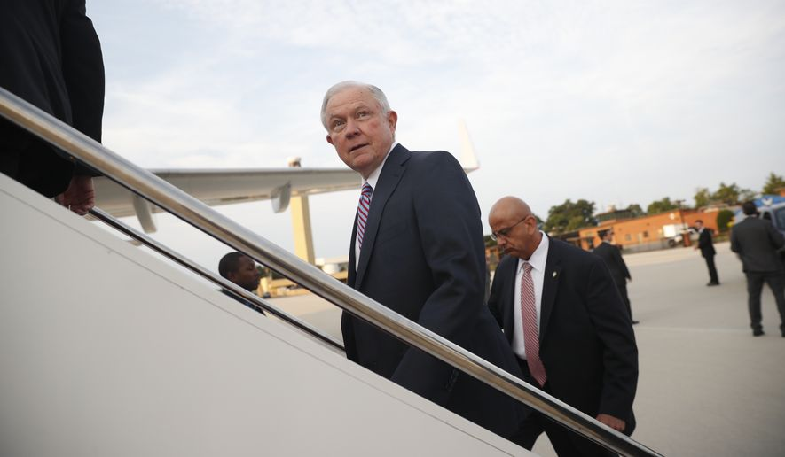 Attorney General Jeff Sessions boards his plane at Andrews Air Force Base, Md., Thursday, July 27, 2017. Sessions is traveling to El Salvador to meet with local leaders and discuss their efforts to fight gangs like MS-13. (AP Photo/Pablo Martinez Monsivais)