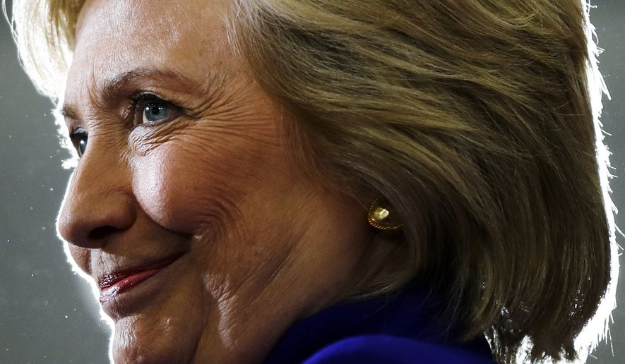 In this Sept. 21, 2016, photo, Democratic presidential candidate Hillary Clinton pauses as she speak during a campaign stop at the Frontline Outreach Center in Orlando, Fla. (Associated Press) **FILE**