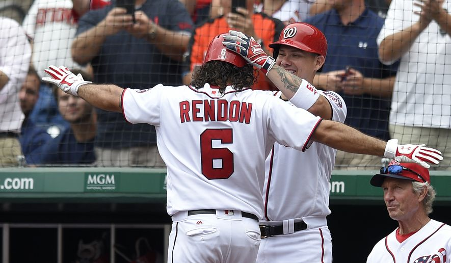 Washington Nationals' Anthony Rendon (6) celebrates his home run with Jose Lobaton, back, during the third inning of a baseball game against the Milwaukee Brewers, Thursday, July 27, 2017, in Washington. (AP Photo/Nick Wass)