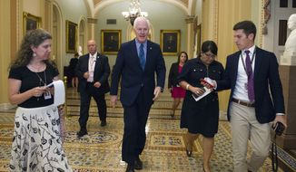 """Senate Majority Whip Sen. John Cornyn of Texas, heads to the Senate Chamber as the Republican majority in Congress remains stymied by their inability to fulfill their political promise to repeal and replace """"Obamacare"""" because of opposition and wavering within the GOP ranks, on Capitol Hill in Washington, Thursday, July 27, 2017. (AP Photo/Cliff Owen)"""
