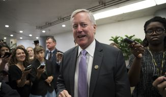 "Rep. Mark Meadows, R-N.C., chairman of the conservative House Freedom Caucus, is stopped by reporters as stops by the Senate as the Republican majority in Congress remains stymied by their inability to fulfill their political promise to repeal and replace ""Obamacare"" because of opposition and wavering within the GOP ranks, on Capitol Hill in Washington, Thursday, July 27, 2017. (AP Photo/J. Scott Applewhite) ** FILE **"