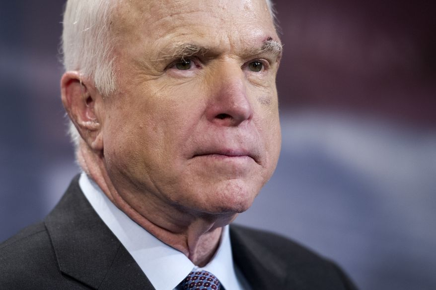 Sen. John McCain, R-Ariz., speaks to reporters on Capitol Hill in Washington, Thursday, July 27, 2017. The Senate voted decisively to approve a new package of stiff financial sanctions against Russia, Iran and North Korea, sending the popular bill to President Donald Trump for his signature after weeks of intense negotiations. The legislation is aimed at punishing Moscow for meddling in the 2016 presidential election and its military aggression in Ukraine and Syria, where the Kremlin has backed President Bashar Assad. McCain said the bills passage was long overdue, a jab at Trump and the GOP-controlled Congress. McCain, chairman of the Armed Services Committee, has called Putin a murderer and a thug.(AP Photo/Cliff Owen)