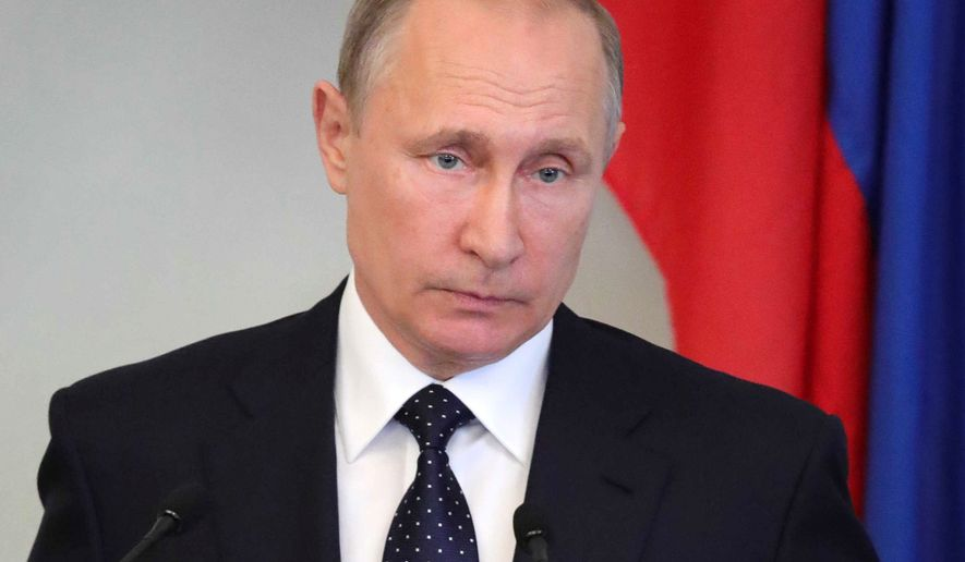 Russian President Vladimir Putin answers questions during a news conference after his talks with and Finnish President Sauli Niinisto in Savonlinna, Eastern Finland, on Thursday, July 27, 2017. President Putin pays a working visit to Finland to discuss bilateral and international issues with his Finnish counterpart and to commemorate Finland's 100-year independence. (Mikhail Klimentyev, Sputnik, Kremlin Pool Photo via AP)