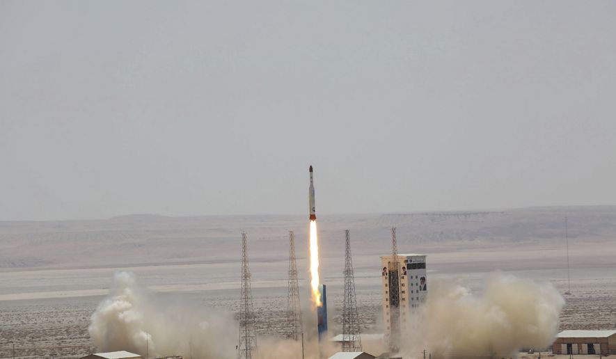 This picture released by the official website of the Iranian Defense Ministry on Thursday, July 27, 2017, claims to show the launching of Simorgh satellite-carrying rocket in an undisclosed location, Iran. (Iranian Defense Ministry via AP)