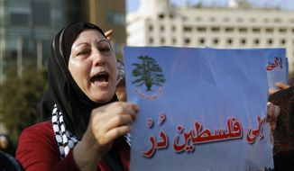 "A Palestinian living in Lebanon chants slogans as she holds a placard with Arabic read ing, ""turn toward Palestine,"" during a sit-in in support of Palestinians and the Jerusalem holy site of Al Aqsa Mosque, in front of the United Nations Headquarters in Beirut, Lebanon, Thursday, July 20, 2017. (AP Photo/Bilal Hussein)"