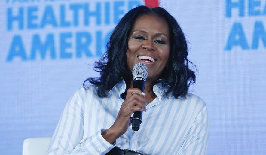 In this Friday, May 12, 2017, file photo, former first lady Michelle Obama smiles while speaking at the Partnership for a Healthier American 2017 Healthier Future Summit in Washington. Obama said at an event for the Women's Foundation of Colorado in Denver on Wednesday, July 26, that breaking the glass ceiling in becoming the first black first lady left a few lasting emotional scars. (AP Photo/Pablo Martinez Monsivais, File)