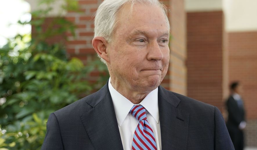 U.S. Attorney General Jeff Sessions starts to walk away after an interview with The Associated Press at the U.S. Embassy in San Salvador, El Salvador, Thursday, July 27, 2017. Sessions is forging ahead with a tough-on-crime agenda that once endeared him to President Trump, who has since taken to berating him. Sessions is in El Salvador to step up international cooperation against the violent street gang MS-13. (AP Photo/Pablo Martinez Monsivais)