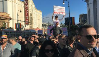 Protesters listen to speakers at a demonstration against a proposed ban of transgendered people in the military in the Castro District, Wednesday, July 26, 2017, in San Francisco. Demonstrators flocked to a plaza named for San Francisco gay-rights icon Harvey Milk to protest President Donald Trumps abrupt ban on transgender troops in the military. (AP Photo/Olga R. Rodriguez)