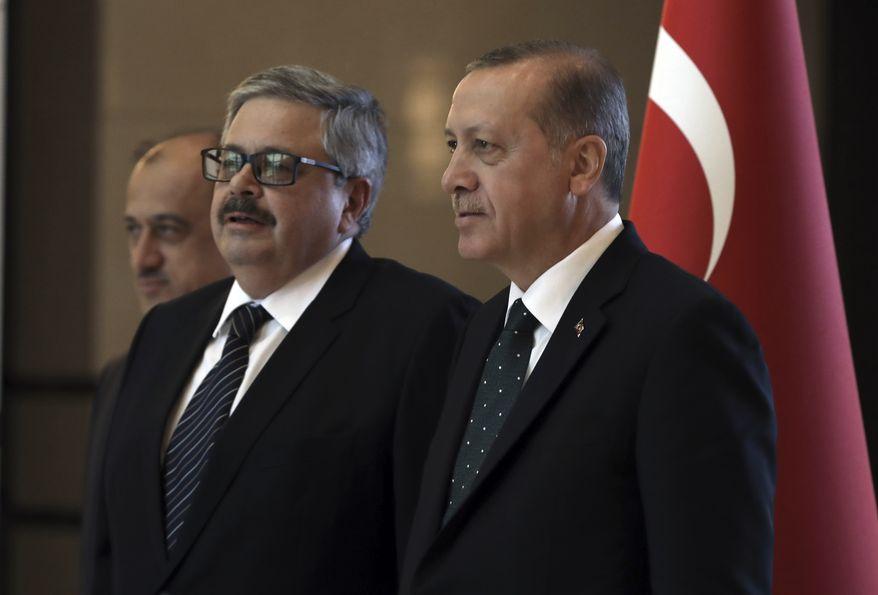 Turkey's President Recep Tayyip Erdogan, right, speaks with the new Russian Ambassador to Turkey, Alexei Yerkhov, as he submits his credentials, in Ankara, Turkey, Thursday, July 27, 2017. (AP Photo/Burhan Ozbilici)