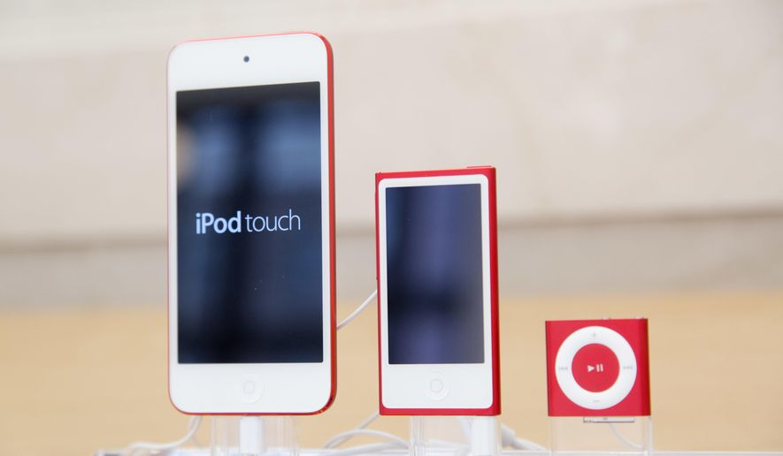 FILE- In this June 11, 2015, file photo, from left, an iPod, iPod Nano and iPod Shuffle are displayed at an Apple store in New York. The company discontinued sales of the iPod Nano and iPod Shuffle on Thursday, July 27, 2017, in a move reflecting the waning popularity of the devices in an era when most people store or stream their tunes on smartphones. (AP Photo/Mark Lennihan, File)