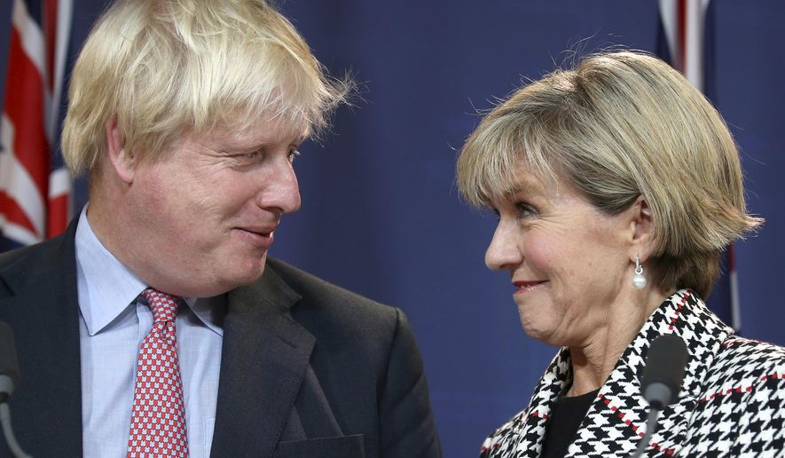 British Foreign Secretary Boris Johnson, left, and Australian Foreign Minister Julie Bishop look at each other during a press conference following their meeting in Sydney, Thursday, July 27, 2017. Johnson said that he supports a proposed free trade agreement between the United Kingdom and Australia, as his country looks to strengthen its relationships with allies ahead of Britain's departure from the European Union. (AP Photo/Rick Rycroft)