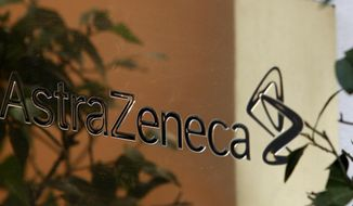 FILE - In this file photo dated Jan. 29, 2009, reflections are seen in the sign at the global headquarters of AstraZeneca in London.  Shares in Anglo-Swedish drugmaker AstraZeneca plunged 16 percent on Thursday July 27, 2017, after a new lung cancer drug trial did not prove as successful as the company had hoped. (AP Photo/Kirsty Wigglesworth/FILE)