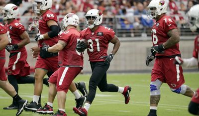 Arizona Cardinals running back David Johnson (31) runs drills during the first day of the team's NFL football training camp, Saturday, July 22, 2017, in Glendale, Ariz. (AP Photo/Matt York)