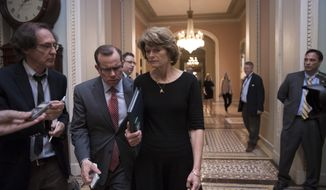 "Sen. Lisa Murkowski, R-Alaska is approached by reporters as she enters the Senate chamber on Capitol Hill in Washington, Thursday, July 27, 2017, as the Republican majority in Congress remains stymied by their inability to fulfill their political promise to repeal and replace ""Obamacare"" because of opposition and wavering within the GOP ranks. (AP Photo/J. Scott Applewhite)"